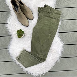 Express distressed green skinny jeans